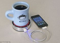 A mobile phone charger that can be powered by either a cold beer or a hot coffee has been unveiled.    The Epiphany One Puck, which doubles as a drinks coaster, connects to a phone with a USB cable.    The charger uses a Stirling engine to convert heat into energy, and it is hoped the gadget will go on sale in 2014 for around £60 from the UK