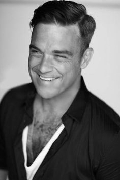 Singer Robbie Williams poses for a portrait shoot by photographer Julian Broad in Los Angeles on May Oliver Twist, Dean Martin, Robbie Williams Take That, S Williams, Sweet Memories, Dream Guy, Male Beauty, Music Bands, American Actors