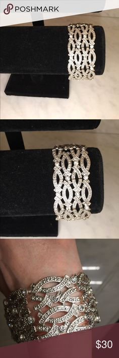 New wide silver and CZ stretchy bracket ‼️HP‼️ This is a brad new bracelet that is good for any occasion. It is strong with elastic to fit most anyone's hand. It is big and stylish with bling! Jewelry Bracelets