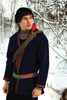 Saami young boy in traditional dress. North Finland.