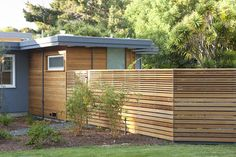 Exterior, new fence and master bathroom addition beyond - midcentury - exterior - san francisco - Klopf Architecture