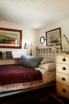 "Wood panelling is painted white in this small [link url=""""]bedroom[/link] belonging to [link url=""""]Plain English[/link] founder Katie Fontana. The gingham bedspread and red throw lend a warm and cosy feel to the room. Small Bedroom Designs, Small Room Design, Small Room Bedroom, Bedroom Sets, Bed Design, Bed Room, Small Bedrooms, Hall Design, Farmhouse Bedroom Decor"