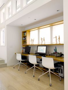 Home or studio office...like how the window is framed to create a wide ledge with storage/cubbies to the side.