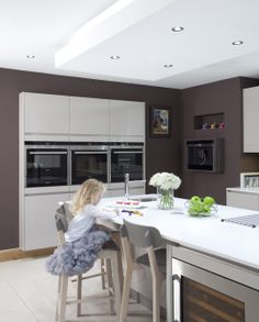 Recessed units featuring Siemens appliances. Fully recessed Siemens coffee machine from Parkes Interiors