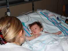 My precious angel Kayla was born December 16, 2006. Two days after her birth we learned she had Tetrology of Fallot, a complex heart defect. The next 3 1/2 months were filled with weekly doctor visits, many tears, unimaginable fear, combatted with lots of prayers. On March 22, 2007, at 3 1/2 months, Kayla underwent open heart surgery to repair the large hole in her heart and patch her pulmonary valve. In this picture she is looking at me for the FIRST time after having her sugary. I'm happy…