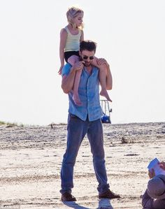 Beach day! Chris Evans carried young co-star Mckenna Grace on his shoulders on Friday as t...