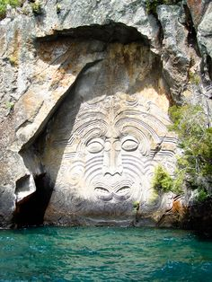 Lake Taupo, New Zealand. Grab a kayak and get up close and personal with the Maori Rock Carvings – these 32-foot-tall carvings are only accessible by water