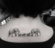 A mother elephant leads her young in this neck tattoo that symbolizes loyalty, motherhood and leadership