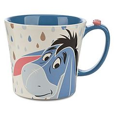 Disney Eeyore Mug   Disney StoreEeyore Mug - Clear the gray clouds away each morning with a sip of virtual sunshine from our hopeful hot beverage mug boasting breezy Eeyore graphics and a tiny sculptured bow on the handle.
