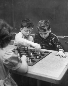 boys playing chess at new york's hunter college 1948  by NINA LEEN
