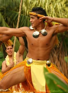 Dancer at Polynesian Cultural Center, Hawaii. The male hula dancers depict scenes of war and celebration.