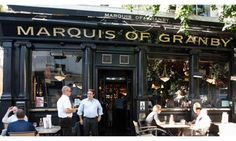 Pints and poetry... the Marquis of Granby on London's Rathbone Street is associated with TS Eliot