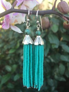 Tassels made of a tiny matte turquoise seed beads with a silver bead tip. These tassels hang 2 inches from the bottom or the sterling silver ear wire.