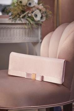 TIE THE KNOT: You'll want to keep Ted's beautiful BOWINA clutch close at hand on your wedding day. Crafted from sumptuous satin and complete with a ladylike bow, it can be swung nonchalantly from one shoulder when you hit the dance floor by its pretty chain strap #WedWithTed