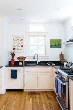 #kitchen, #kitchen-cabinets, #home-tour  Photography: Joyelle West - www.jwestwedding.com  Read More: http://www.stylemepretty.com/living/2014/06/24/vintage-home-tour/