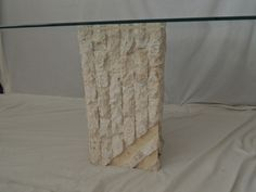One of three column style 1970s travertine tables available.  Two end tables and one end table in this style.