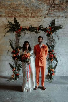 Tropical Flower and Leaf Wedding Ceremony Arch Decor   By Millar Cole Photography   Vibrant Wedding   Colourful Wedding   Tropical Wedding Flowers   White Sari for Wedding   Orange Wedding Suit   Legnhas for Bridesmaids   London Wedding   Industrial Wedding   Neon Wedding Signs Wedding Ceremony Arch, Wedding Sari, Wedding Party Dresses, Wedding Suits, White Wedding Flowers, Orange Wedding, Wedding Colors, White Sari, When We Get Married