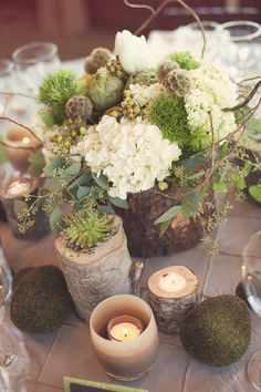 Gorgeous rustic centerpieces, especially love the hydrangea, grapevine, moss, and birch elements.