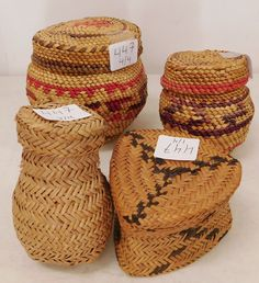 """447: 4 Native American Baskets, circa 1950s-60s. Made of cedar bark, grass, pine needles, the items are 2"""" to 3 7/8"""" tall. Tarahumara, Mexico, Makah, Canada. 2 nice NWC baskets with nice color and 2 finely weaved Tarahumara pine needle baskets, one with attached lid. Condition: Good, see images. Shipping: $22.50 w/insurance and signature Native American Baskets, Pine Needle Baskets, Pine Needles, Nativity, Grass, 1950s, Mexico, Auction, Canada"""
