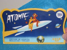 Whoosh! To the moon! The Atomic company imagined space travel somehow related to sewing. Okay. This paper needle case is full of assorted hand needles,