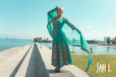 Beautiful Teal color suit with gold embroidery. For more info contact sales@sahil.com