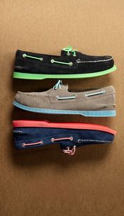 Men's suede boat shoes with colorful soles.