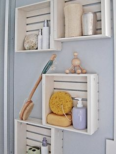 DIY crate shelves. With a couple of slats across the front, voila, magazines or small books or kitchen items.