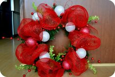 "How to Make deco mesh wreaths | ... set of deco mesh ""poufs"" sort of in the back/top of the wreath"