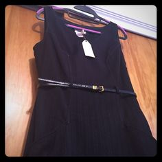NWT Max Studio Specialty Products Dress NWT but missing belt that goes around waist. I added my *belt to show what it can look like with a belt.  Awesome as a work dress.   Size 6   Brand: MSSP (Max Studio Specialty Products)   Style: Annabella   Color: Black pinstripe  2 pockets, side zip.      *note belt not included         Will consider any reasonable offer. Max Studio Dresses Midi