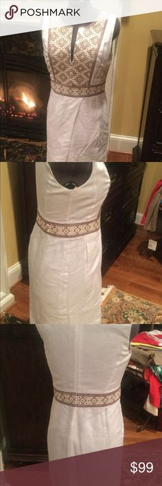 Tory Burch winter white dress Tory Burch winter white dress midi length, hits below knee.  Split neckline.  Decorative embroidery on bodice and at waistline, pleated skirt.  Size 10 and in excellent condition.  Fully lined. Tory Burch Dresses Midi