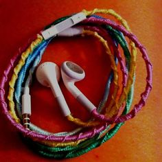 "string-knotting [AKA ""friendship bracelet""] technique to keeps ear buds from bunching up...details here"