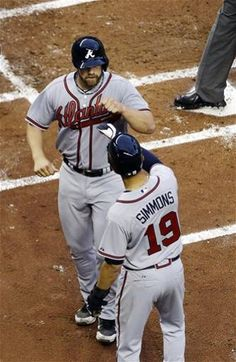 Evan Gattis #24 of the Atlanta Braves celebrates after hitting a two-run home run against the Miami Marlins Andrelton Simmons
