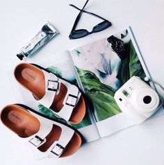 a good magazine and instax camera are beach bag essentials