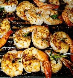 Grilled shrimp with olive oil and herb sauce. Barbecued shrimp with parsley, rosemary and basil.