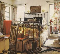 Romantic cowgirl bedroom! I love the cast-iron star finials, too.
