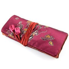 "Silky Jewelry Roll / Cosmetic Roll Travel Pouch with Floral Dragon Print Embroidering - Burgundy by Evolatree. Save 56 Off!. $14.49. Silky soft material made from a Silk & Rayon blend. Dimensions: Rolled 7.5"" x 3.5 "" / Open 7.5"" x 10"". Three zippered compartments, one large compartment, and one ring holder. Perfect for keeping your rings, earrings, bracelets and other jewelry or cosmetic accessories."