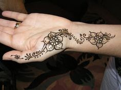 A Simple Floral Henna Design Start from thumb to wrist.