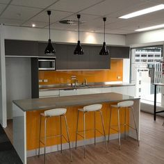 If only every office break room could look this good. Make the break room more lively with Caesarstone countertops and the use of color. Design: MMI - Mark Manolas Interiors Limited