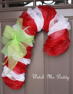 Mesh Candy Cane Wreath - Pretty door decoration and fun alternative to traditional Christmas wreath crafts.But I need to find wire hangers. Noel Christmas, Christmas Candy, All Things Christmas, Winter Christmas, Holiday Fun, Christmas Wreaths, Christmas Decorations, Country Christmas, Funny Christmas