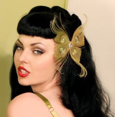 Not really a fascinator, but would suit in a pinch. Although the lamprey face the model is making sorta puts me off.