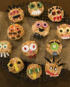 Monster Cupcakes | Martha Stewart Living - A band of monsters, ogres, and madmen casts an ominous spell from the tops of otherwise innocent cupcakes.