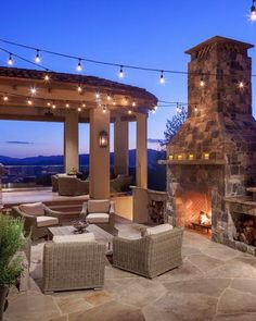 This outdoor patio with its exterior detailing, dramatic stone fireplace, built-in grill and seating is the perfect setting for wining and dining with friends and family.
