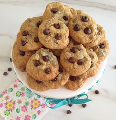 Chocolate chip cookies doctored up with dark chocolate chips, coconut, and chopped pecans! #recipe #thegoldlininggirl