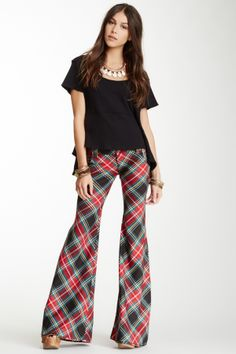"""Flare Leg Pants in red plaid by Plaid Teaspoon $128 - $59 @HauteLook. [front] - Zip fly with button closure - 4 pocket construction - Wide flare leg - Allover plaid print - Approx. 8"""" rise, 33"""" inseam Fit: this style fits true to size. Model's stats: - Height: 5'11""""  - Waist: 23""""  - Hips: 34.5""""  Model is wearing size 4. Machine wash 64% polyester, 34% rayon, 2% spandex"""