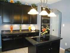 Another view of the kitchen and island with cooktop