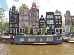 Amsterdam / Did you ever wonder why the houses in Amsterdam are so 'NARROW'? - Homeowners pay their taxes on the measurement of their home's 'frontage' .