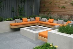 Charlotte Rowe - courtyard garden with built in bench seat fixed to rendered retaining wall /planter box