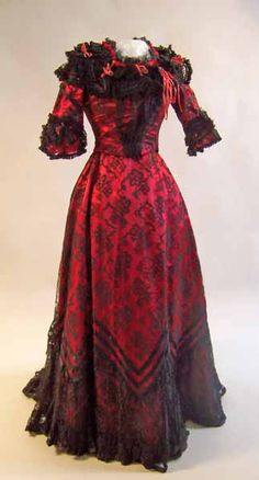 Collection | Manchester Art Gallery 1899 Two piece evening or dinner costume in scarlet silk satin, covered with black machine lace and trimmed with ruched red and black chiffon, pleated black lace and narrow red velvet ribbon.
