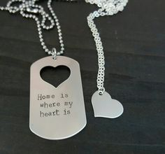 The perfect set for a military couple, deployed or not! The gentlemans necklace is a stainless steel dog tag with a heart cut out, hand stamped to say Home is where my heart is on a thick 24 inch stainless steel ball chain. The ladies necklace carries the gentlemans heart with a