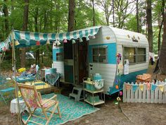 vintage turquoise travel trailer and outside decor.  This is adorable, I still haven't decided what color to paint our teeny  guest trailer. :)